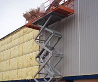 commercial insulation applied to the exterior of a warehouse