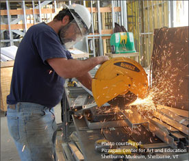 Optimum Building Systems specialist cuts metal framing at the Pizzagalli Center for Art and Education, Shelburne Museum, Shelburne, VT